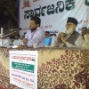 Muhammad Kunni delivering Quran discourse in kannada Maulana Sirajul Hasan can be seen
